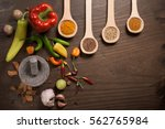 hot peppers  seeds  spices and... | Shutterstock . vector #562765984