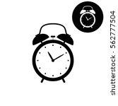 alarm clock    white vector icon | Shutterstock .eps vector #562777504