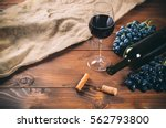bottle and glass of red wine ... | Shutterstock . vector #562793800