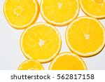 the cut orange on segments.... | Shutterstock . vector #562817158