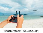 remote control in the hands of... | Shutterstock . vector #562856884