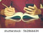 man using smarphone make note... | Shutterstock . vector #562866634