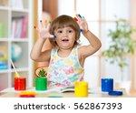 cheerful kid girl showing her... | Shutterstock . vector #562867393