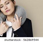 caucasian woman travel pillow... | Shutterstock . vector #562869544