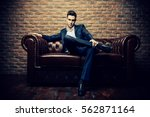 imposing well dressed man in a... | Shutterstock . vector #562871164