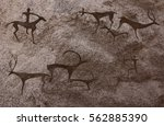cave paintings of primitive man.... | Shutterstock . vector #562885390