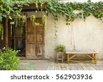 wood door and bamboo bench with ... | Shutterstock . vector #562903936