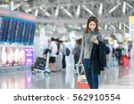 Small photo of Charming beautiful business woman smile in casual style using smartphone with blur the airport terminal.