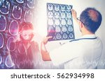 doctor holding x ray or... | Shutterstock . vector #562934998