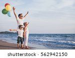 father and children with... | Shutterstock . vector #562942150