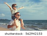 father and son playing in the... | Shutterstock . vector #562942153