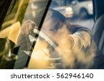 tired working woman asleep on... | Shutterstock . vector #562946140
