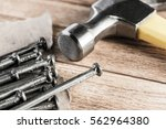 home repair concept with hammer ... | Shutterstock . vector #562964380