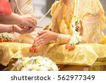hand of a bride receiving holy... | Shutterstock . vector #562977349