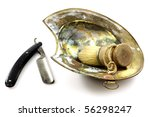 Old razor with cover and shaving dish on a white background - stock photo