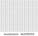 knitted woolen texture.... | Shutterstock .eps vector #562990993