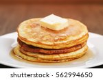 homemade pancakes with butter... | Shutterstock . vector #562994650
