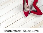 red female shoes on high heels... | Shutterstock . vector #563018698