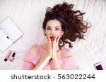 Shocked Brunette Lying On Bed...
