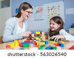 preschool teacher and cute girl ... | Shutterstock . vector #563026540