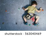 little boy climbing a rock wall ... | Shutterstock . vector #563040469