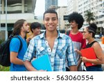 happy hipster male student with ... | Shutterstock . vector #563060554