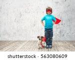 little hero with dog indoors | Shutterstock . vector #563080609
