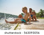 happy family at a lake having... | Shutterstock . vector #563093056