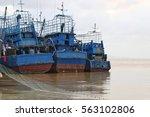 fisherman boat in harbor | Shutterstock . vector #563102806