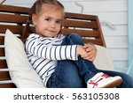 pretty small girl in jeans and... | Shutterstock . vector #563105308