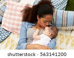 overhead view of mother with... | Shutterstock . vector #563141200