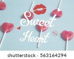 heart lollipop on blue...   Shutterstock . vector #563164294
