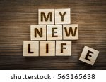 """Small photo of """"My New Life"""" inscription made from wooden blocks"""