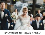 the brides with bouquet going ... | Shutterstock . vector #563177560