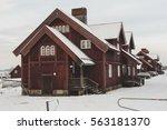 wooden red houses in kiruna... | Shutterstock . vector #563181370