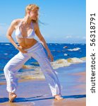 active girl on a beach | Shutterstock . vector #56318791