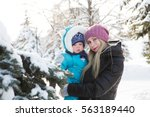 baby boy and his mother playing ... | Shutterstock . vector #563189440