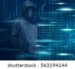 hacker with mask on dark green...   Shutterstock . vector #563194144