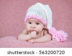 beautiful little girl in pink...   Shutterstock . vector #563200720