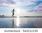woman is jumping to sky on... | Shutterstock . vector #563212150
