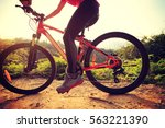 one young woman cyclist riding... | Shutterstock . vector #563221390