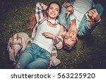 cheerful couple taking selfie... | Shutterstock . vector #563225920