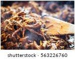 frying the pulled pork | Shutterstock . vector #563226760