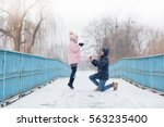 marriage proposal. man hold... | Shutterstock . vector #563235400