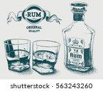 two glasses of alcohol  bottle... | Shutterstock .eps vector #563243260