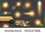 isolated golden lens flare.... | Shutterstock .eps vector #563267686