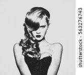 fashion portrait of beautiful... | Shutterstock . vector #563276743