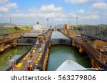 Small photo of The first lock of the Panama canal from the Pacific ocean. The gateway is located within the modern state of Panama. The photograph shows grey design of a movable bridge.