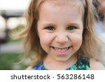 closeup portrait of smiling... | Shutterstock . vector #563286148