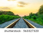railroad in motion at sunset.... | Shutterstock . vector #563327320